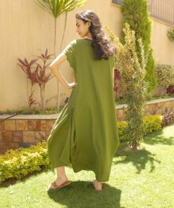 Apple green Siwa embroidered linen dress handmade in Egypt & available at Jozee Boutique.